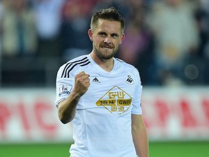 Swansea player Gylfi Sigurdsson celebrates after scoring the second Swansea goal during the Capital One Cup Third Round match against Everton on September 23, 2014