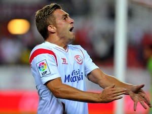 Sevilla's forward Gerard Deulofeu celebrates after scoring during the Spanish league football match Sevilla FC vs Real Sociedad at the Ramon Sanchez Pizjuan stadium in Sevilla on September 24, 2014