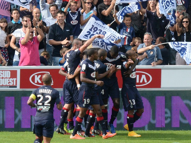 Bordeaux' s Thomas Toure is congratulated by teammates after scoring the second goal during the French L1 footbal match Bordeaux vs Rennes on September 28, 2014
