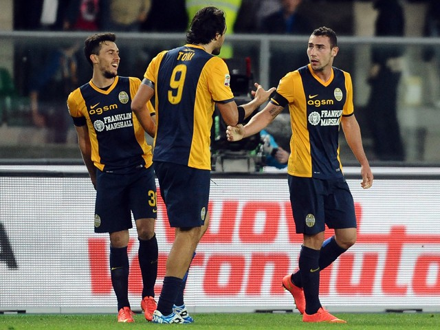Artur Ionita # 23 of Hellas Verona FC celebrates after scoring his team's second goal during the Serie A match between Hellas Verona FC and Genoa CFC at Stadio Marc'Antonio Bentegodi on September 24, 2014