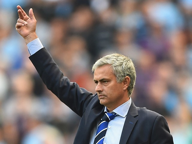 Jose Mourinho of Chelsea gives out instructions during the Barclays Premier League match between Manchester City and Chelsea at Etihad Stadium on September 21, 2014