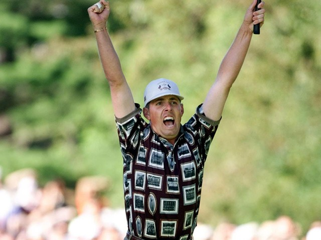 US Ryder Cup team member Justin Leonard celebrates his putt against Jose Maria Olazabal of Spain on the 17th hole that clinched the victory for the US in the 33rd Ryder Cup 26 September, 1999