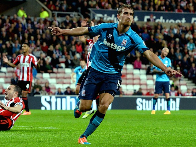 Marc Muniesa of Stoke City (R) celebrates after scoring their first goal during the Capital One Cup Third Round match against Sunderland on September 23, 2014
