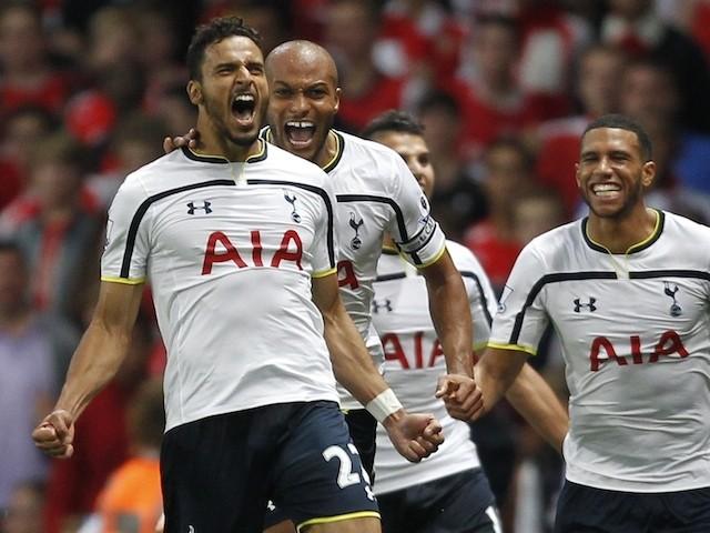 Tottenham Hotspurs Belgium midfielder Nacer Chadli (L) celebrates scoring a goal during the English Premier League football match between Arsenal and Tottenham Hotspur on September 27, 2014