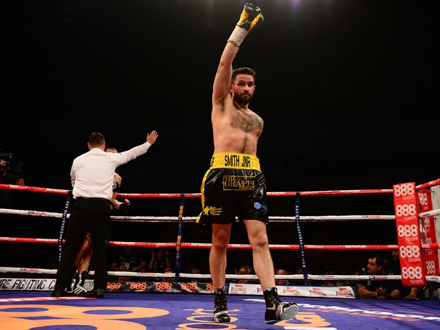 Paul Smith celebrates as the Referee stops his fight against David Sarabia during their Super Middleweight bout at the Motorpoint Arena on May 17, 2014