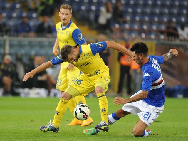 Perparim Hetemaj of AC Chievo Verona is tackled by Roberto Soriano of UC Sampdoria during the Serie A match between UC Sampdoria and AC Chievo Verona at Stadio Luigi Ferraris on September 24, 2014