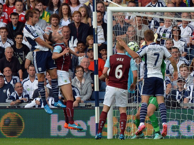 West Bromwich Albion's English defender Craig Dawson scores a goal during the English Premier League football match between West Bromwich Albion and Burnley at the Hawthorns in West Bromwich on September 28, 2014