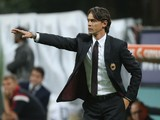 Head coach of Milan Filippo Inzaghi gestures during the Serie A match between AC Milan and AC Chievo Verona at Stadio Giuseppe Meazza on October 4, 2014