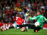 Danny Welbeck of Arsenal scores his team's second goal past Fernando Muslera of Galatasaray AS during the UEFA Champions League group D match between Arsenal FC and Galatasaray AS at Emirates Stadium on October 1, 2014