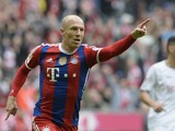 Bayern Munich's Dutch midfielder Arjen Robben celebrates scoring the 2-0 goal during the German first division Bundesliga football match FC Bayern Munich vs Hanover 96 at the Allianz Arena in Munich, southern Germany on October 4, 2014