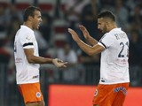 Montpellier's Brazilian defender Vitorino Hilton celebrates with Moroccan defender Abdelhamid El Kaoutari after scoring a goal during the French L1 football match between Nice and Montpellier at the Allianz Riviera stadium in Nice, southeastern France, on