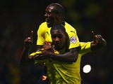 Odion Ighalo of Watford (front) celebrates with Lloyd Dyer as he scores their first goal during the Sky Bet Championship match against Brentford on September 30, 2014