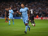 Sergio Aguero of Manchester City celebrates scoring the opening goal from a penalty kick during the UEFA Champions League G