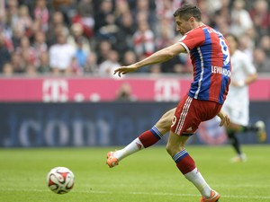 Bayern Munich's Polish striker Robert Lewandowski scores the 1-0 goal during the German first division Bundesliga football match FC Bayern Munich vs Hanover 96 at the Allianz Arena in Munich, southern Germany on October 4, 2014