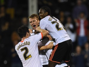 Fernando Amorebieta of Fulham is buried by team mates after scoring his team's second goal during the Sky Bet Championship match between Fulham and Bolton Wanderers at Craven Cottage on October 1, 2014