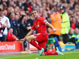 Jordan Henderson of Liverpool celebrates scoring their second goal during the Barclays Premier League match between Liverpool and West Bromwich Albion at Anfield on October 4, 2014