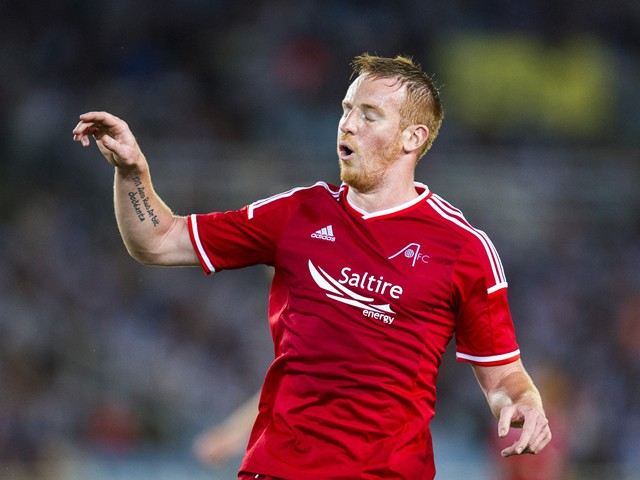 Adam Rooney of Aberdeen FC reacts during the UEFA Europa League third round qualifying first leg match between Real Sociedad and Aberdeen FC at Estadio Anoeta on July 31, 2014