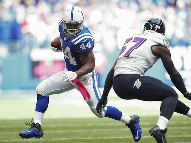 Ahmad Bradshaw #44 of the Indianapolis Colts looks for running against C.J. Mosley #57 of the Baltimore Ravens at Lucas Oil Stadium on October 5, 2014