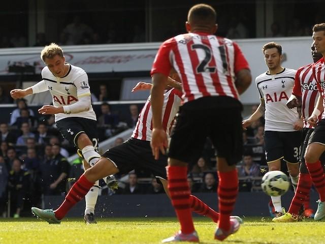 Tottenham Hotspur's Danish midfielder Christian Eriksen (L) scores the opening goal of the English Premier League football match between Tottenham Hotspur and Southampton on October 5, 2014