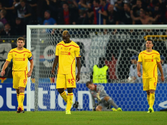 Dejected Steven Gerrard and Mario Balotelli of Liverpool after conceding the first goal during the UEFA Champions League Group B match between FC Basel 1893 and Liverpool FC at St. Jakob Stadium on October 1, 2014