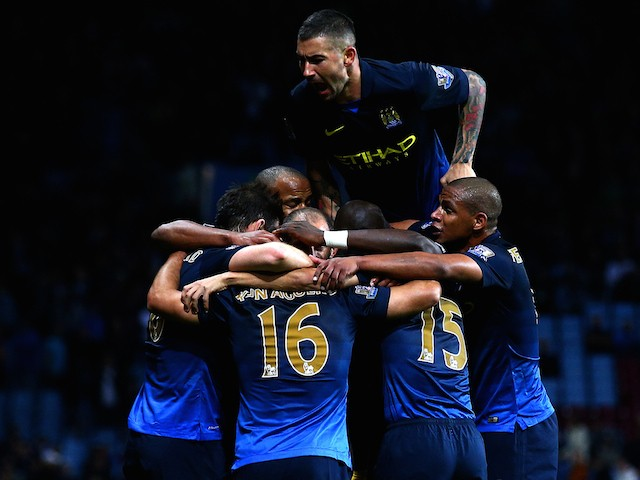 Sergio Aguero of Manchester City celebrates with teammates after scoring their second goal during the Barclays Premier League match against Aston Villa at Villa Park on October 4, 2014