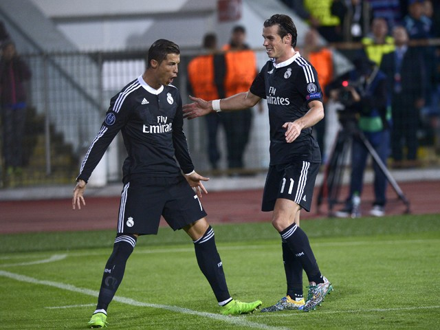 Real Madrid's Portuguese forward Cristiano Ronaldo celebrates with his teammate Gareth Bale after scoring a penalty during the UEFA Champions League Group B match between Ludogorets Razgrad and Real Madrid at the Vassil Levski stadium in Sofia on October