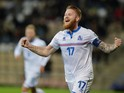 Iceland's Aron Gunnarsson celebrate after scoring during their Euro 2016 qualifier football match Latvia vs Iceland in Riga on October 10, 2014