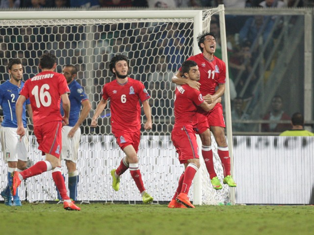 Azerbaijan's Rauf Aliyev celebrates after scoring during the UEFA Euro 2016 group H qualifying football match between Italy and Azerbaijan on October 10, 2014
