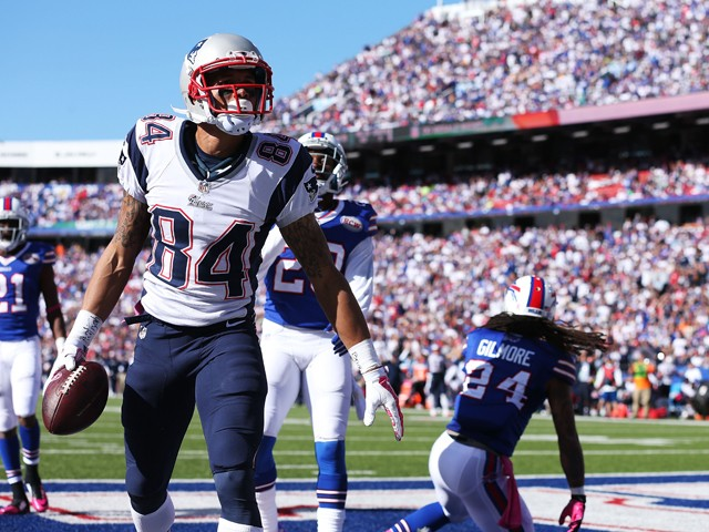 Brian Tyms #84 of the New England Patriots celebrates a touchdown catch against the Buffalo Bills during the second half at Ralph Wilson Stadium on October 12, 2014