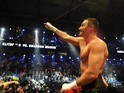 Ukrainian WBC heavyweight champion Vitali Klitschko celebrates defeating US boxer Shannon Briggs fight in the WBC heavyweight world championship boxing match in the northern German city of Hamburg on October 16, 2010
