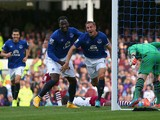 Phil Jagielka of Everton turns to celebrate after scoring the opening goal during the Barclays Premier League match between Everton and Aston Villa at Goodison Park