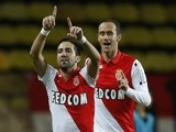 Monaco's Portuguese midfielder Joao Moutinho (L) celebrates after scoring a goal during the French L1 football match Monaco (ASM) vs Evian-Thonon (ETGFC) on october 18, 2014