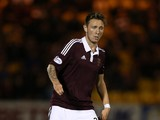 Jordan McGhee of Hearts controls the ball during Petrofac Training Cup second round match between Livingston and Hearts at Almondvale Stadium on August 20, 2014