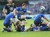 Eoin Reddan of Leinster kicks the ball upfield during the European Rugby Champions Cup match between Leinster and Wasps at the RDS Arena on October 19, 2014