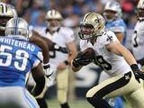 Josh Hill #89 of the New Orleans Saints looks to gain yards against the Detroit Lions in the second quarter at Ford Field on October 19, 2014