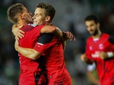 Sevilla's French forward Kevin Gameiro celebrates his goal with Sevilla's Portuguese midfielder Daniel Carrico during Spanish league football match Elche CF vs Sevilla FC at the Martinez Valero stadium in Elche on October 19, 2014