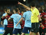 Vitor Saba of the Wanderers scuffles with Corey Gameiro of Sydney FC after being shown a red card during the round two A-League match between Sydney FC and the Western Sydney Wanderers at Allianz Stadium on October 18, 2014