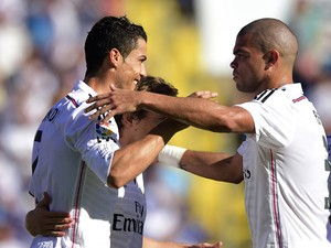 Real Madrid's Portuguese forward Cristiano Ronaldo celebrates his goal with Real Madrid's Portuguese defender Pepe during the Spanish league football match on October 18, 2014