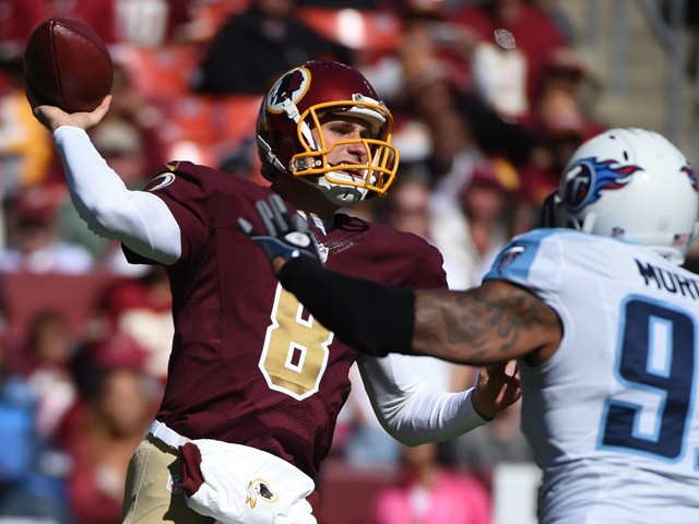 Kirk Cousins #8 of the Washington Redskins passes against Derrick Morgan #91 of the Tennessee Titans during first quarter at FedEx Field on October 19, 2014