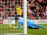 Alexis Sanchez of Arsenal rounds goalkeeper Vito Mannone of Sunderland to score histeam'ssecond goal during the Barclays Premier League match between Sunderland and Arsenal at the Stadium of Light on October 25, 2014