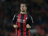 Brett Pitman of AFC Bournemouth in action during the Capital One Cup Second Round match between AFC Bournemouth and Northampton Town at Goldsands Stadium on August 26, 2014