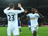 Swansea City striker Wilfried Bony celebrates with teammate Gylfi Sigurdsson after scoring the opening goal against Leicester City in the Premier League on October 25, 2014