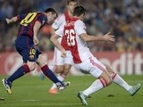 Barcelona's Argentinian forward Lionel Messi (L) scores during the UEFA Champions League football match FC Barcelona vs Ajax Amsterdam at the Camp Nou stadium in Barcelona on October 21, 2014