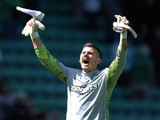 Lukasz Zaluska of Celtic celebrates at full-time following the Clydesdale Bank Premier League match between Hibernian and Celtic at Easter Road on July 24, 2011