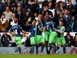 Sammy Ameobi of Newcastle United celebrates with team-mates after scoring his team's first goal during the Barclays Premier League match between Tottenham Hotspur and Newcastle United at White Hart Lane on October 26, 2014