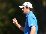 Peter Whiteford of Scotland celebrates a birdie during day two of the Perth International at Lake Karrinyup Country Club on October 24, 2014