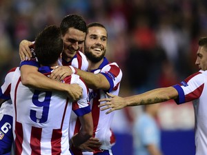 Atletico Madrid players celebrate after scoring their second goal during the UEFA Champions League football match Club Atletico de Madrid vs Malmo FF at the Vicente Calderon stadium in Madrid on October 22, 2014