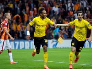Dortmund's Gabonese forward Pierre-Emerick Aubameyang celebrates with Dortmund's Armenian forward Henrikh Mkhitaryan after scoring a goal the UEFA Champions League Group D football match between Galatasaray and Borrusia Dortmund on October 22, 2014