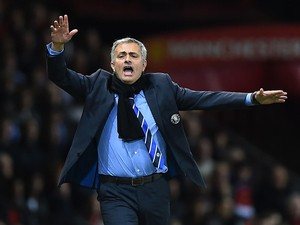 Chelsea Manager Jose Mourinho protests during the Barclays Premier League match between Manchester United and Chelsea at Old Trafford on October 26, 2014