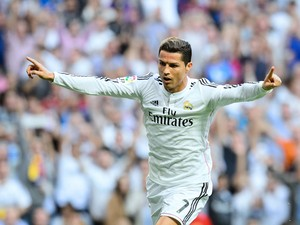 Real Madrid's Portuguese forward Cristiano Ronaldo celebrates after scoring during the Spanish league 'Clasico' football match Real Madrid CF vs FC Barcelona at the Santiago Bernabeu stadium in Madrid on October 25, 2014.